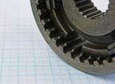Gear on graph paper — Stock Photo