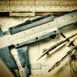 Old engineering tools on a technical drawing — Stock Photo