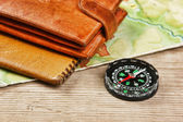 Old map and compass on a wooden table — Stock Photo