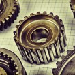 Old gears on graph paper — Stock Photo #26870297