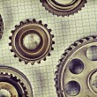 Old gears on graph paper — Stock fotografie