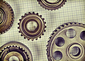 Old gears on graph paper — Stock Photo