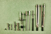 Old drawing tools on a green background — Stok fotoğraf