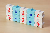 Educational blocks with math problems on the table — Stock Photo