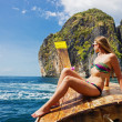 Young girl in bikini sitting on boat on the beach Maya Bay Phi — Stock Photo #27068777