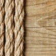 Frame made of rope on a wooden background — Stock Photo