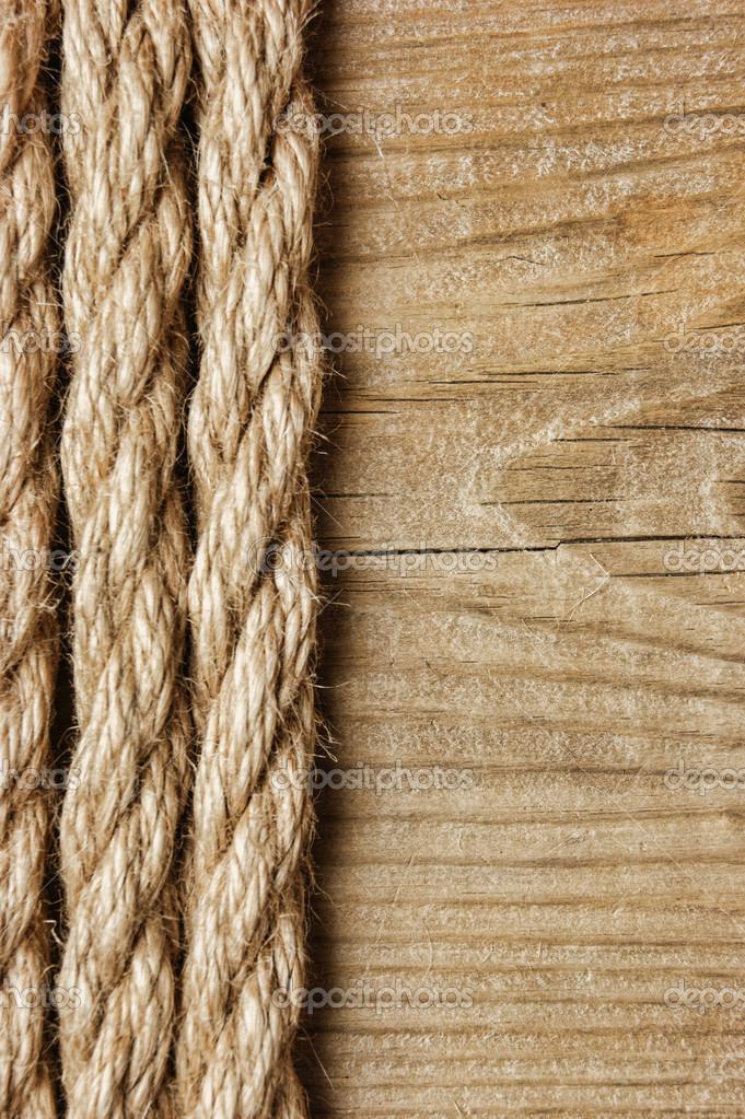 quadro feito de corda em um fundo de madeira — Foto Stock