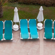 Empty sun loungers by the pool — Stock Photo