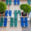Stock Photo: Empty sun loungers by pool