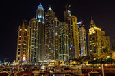 DUBAI, UAE - NOVEMBER 16: Night view Yacht Club in Dubai Marina, on November 16, 2012, Dubai, UAE. In the city of artificial channel length of 3 kilometers along the Persian Gulf. — Stock Photo