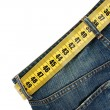 Jeans with meter belt slimming isolated on the white background — Stock Photo