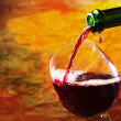 Stock Photo: Red wine being poured into wine glass