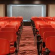 Rows of red chairs in empty conference hall — Stock Photo #30029507