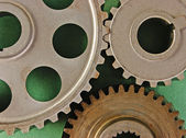 Gears on a green background — Stock fotografie