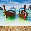 Traditional longtail boats in the famous Maya bay of Phi-phi Leh island — Stock Photo #31097565