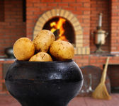 Cast iron pot with a potato in Russian cuisine — Stock Photo