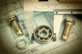 Old technical drawing and caliper with bearing — Stock Photo