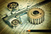 Old technical drawing and pinion with bearings — Stock Photo