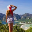 Stock Photo: Girl at the resort in a dress on the background of the bays of t