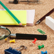 Office supplies in a mess on the table — Stockfoto
