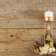 Christmas decoration candlestick on the old wooden background — Stock Photo