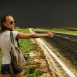 Stock Photo: Young girl votes on deserted road