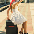 Stock Photo: Young girl with a suitcase
