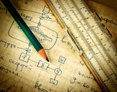 Pencil and a slide rule on the old page with the calculations in mechanics — Stock Photo