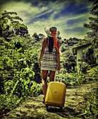 Young girl with a bag goes on the road — Stock Photo