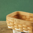 Empty wicker basket on a wooden table — Stock Photo