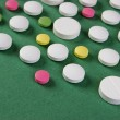 Pills and tablets on a green background — Foto de Stock