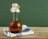 Bottle with vegetable oil on a wooden table — Stock Photo