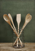Wooden kitchenware in metal basket — Stock Photo