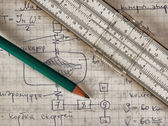 Pencil and a slide rule — Stock Photo
