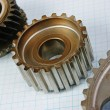Two gears on graph paper — Stock Photo