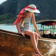 Young girl in a wooden boat on the island of Phuket Thailand — Stock Photo