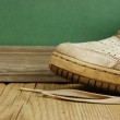Old leather shoes on a wooden floor — Stock Photo