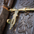 Old deadbolt on wooden door — Stock Photo
