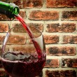 Red wine and wine glass — Stock Photo #37488869
