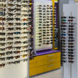 Stock Photo: Glasses on display in store optics