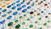 Rings with precious stones in the gold market of Dubai — Stock Photo