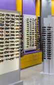 Glasses on display in a store optics — Stock Photo