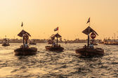 Traditional Abra ferries at sunset in Dubai — Stock Photo