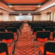 Rows of red chairs in empty conference hall — Stock Photo #37830329