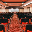 Rows of red chairs in empty conference hall — Stock Photo #38407433