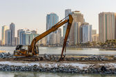 Excavator on a construction site in the UAE — ストック写真
