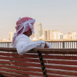 Stock Photo: Arab men on waterfront