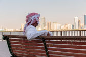 Arab men on the waterfront — Stock Photo