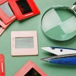 Stock Photo: Old slides and magnifying glass