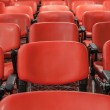 Rows of red chairs in empty conference hall — Stock Photo #40658043